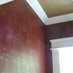 Walls stencilled in gold and antiqued
