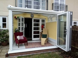 Bifold doors within a conservatory