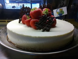 WHITE CHOCOLATE TORTE & STRAWBERRIES