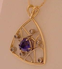 Tanzanite and Diamond pendant in 18ct Yellow and White Gold , designed and Handmade by Phillip Godfrey