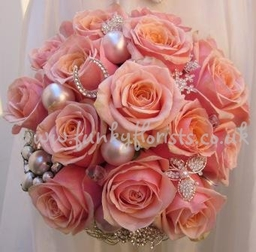 coral roses with brooches