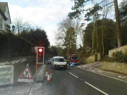 Working on busy road using traffic lights