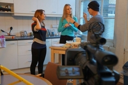 Bruce Alexander directs two students during a shoot.
