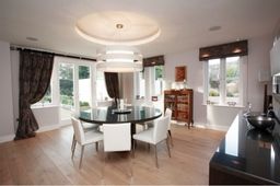 A contemporary dinning room incorporating some of the client's heirloom furniture