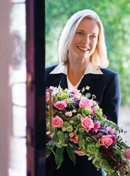 Lady Funeral Director With Flowers