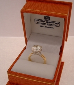 Diamond solitaire in an 18ct and Platinum ring mount designed and handmade by Phillip Godfrey , ring is made to order and available in any precious metal combination or stone size