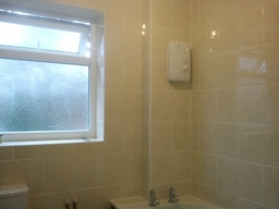 Bathroom Walls With Ceramic Tiles In Brickbond Pattern