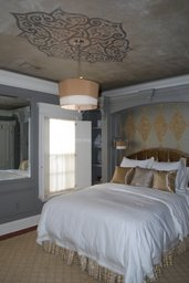 Design on ceiling and wall behind bed