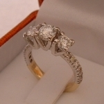 3 stone Diamond ring with smaller Diamonds set beneath them Deisgned and Handmade by phillip Godfrey