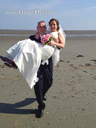 Groom carries his bride home from the Louth Beach