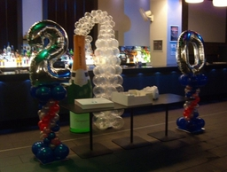 Champagne Bubbly display, foil numbers on spiral pedestals