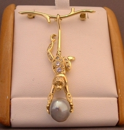 18ct yellow gold Monkey Brooch , Set with Diamonds and a Grey Tahitian Pearl , the monkey swings on the branch and has a jointed tail , Handmade by Phillip Godfrey