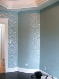Stencilled walls in shimmery metallic glaze