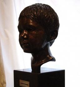 Completed head in bronze.
