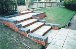 Paved entrance steps with brick work