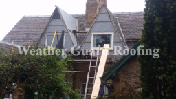 Dormer roofs being constructed