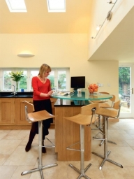 Bespoke oak kitchen with raised glass bar