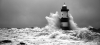 Penmon Point lighthouse in storm