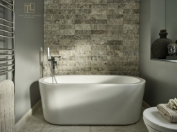 Family bathroom with self standing bath in a property that doubled its price valuation after the work was completed designed and installed by Tailored Living Interiors