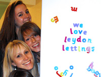 picture of leydon students tenants peering from behind a fridge withthe word we love leydon lettings written with fridge magnets