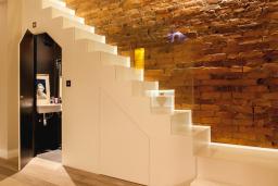 Weybridge staircase with cloakroom underneath
