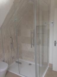 Shaped shower enclosure