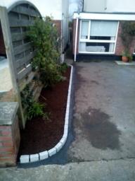 granite kerb and raised flower bed Knocklyon