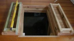 Bespoke trap doors to built in wine cellar beneath