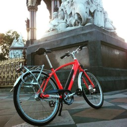 Red crossbar Emu electric bike in London