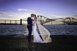 Wedding portrait by the Forth bridges.