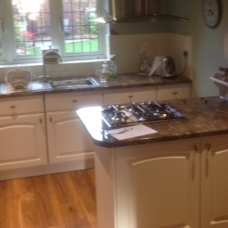 After. A Brighter transformation achieved by changing the doors and worktops