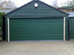 Doco grooved Sectional Garage Door in bespoke green