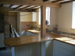 Oak worktops, we had to fit arrount the Oak post.