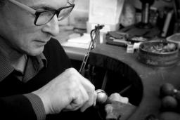 Jewellery designer West Sussex. Andrew Leggett of Aurum jewellers at his bench.