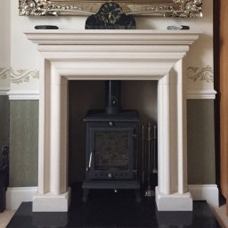A Portland stone fireplace