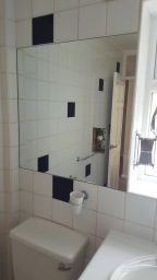 Mirrors with cut out for sockets
