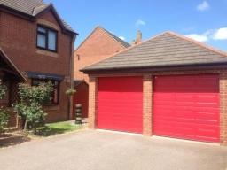 Cartek Insulated Sectional Garage Doors in red