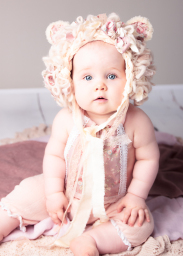 baby in pink teddy outfit