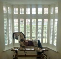 Bi-fold wooden shutters