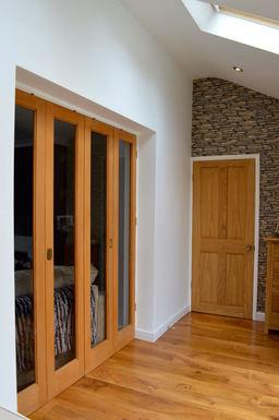 Double Bi-Fold Doors & 4 Panel Colonial Door.