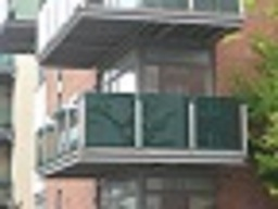 Forest green fabric balcony screen attached