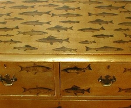 Gilt and fish decoupage on a 19th century chest