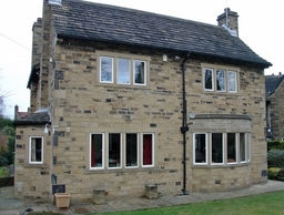 Our slim thermally efficient and secure aluminium steel replacement windows perfectly installed between the stone work in this local property.