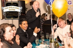 Surpise Singing Waiters