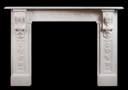 Stock No 3751 - £16000 + VAT Victorian English Statuary marble fireplace. The panelled jambs with carved flowers and foliage throughout with elaborately carved corbels above