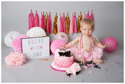 Super fun & super messy Surrey Cake Smash photographs.