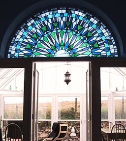 Stained glass arch in a conservatory. Designed and made by Artisan Stained Glass