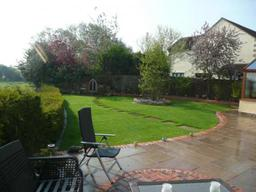 Sandstone and reclaimed brick patio paving in a garden in Wiltshire