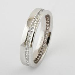 Bespoke Wedding Band .Princess cut diamonds .Channel set in 18ct white gold.