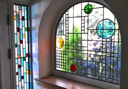 Stained glass windows for a vestibule designed and made by Artisan Stained Glass for customers in Perthshire